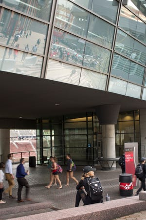 University of Cincinnati students pass under the Campus Recreation Center on UC's main campus in Clifton, Thursday, April 11, 2019. Total enrollment for 2018-2019 was 45,949. The university attracts students from all 50 states and 114 countries.