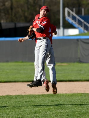 Coshocton's Griffin Mason, left, and Brody Hammersley celebrate a big out in the sixth inning of a 5-4 win against host Zanesville on Monday at Jay Payton Field.