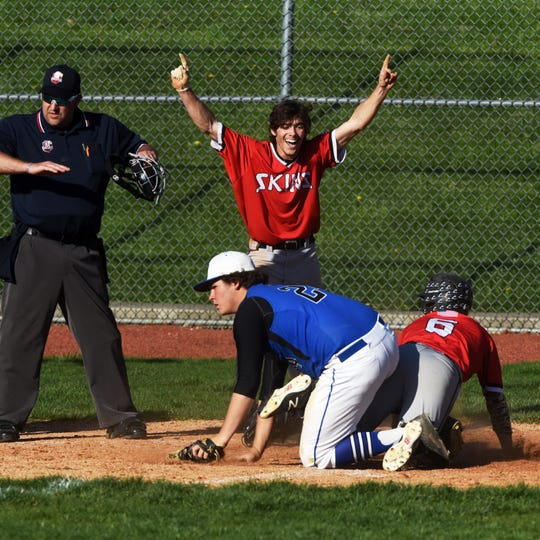 Andrew Tomak, of Coshocton, celebrates after Andrew Kittell scores a run in the sixth inning against  host Zanesville on Monday at Jay Payton Field. The Redskins won, 5-4.