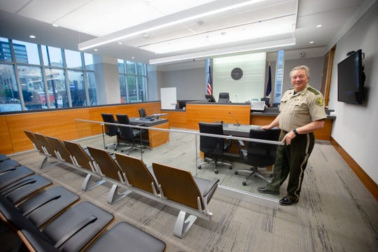 Sheriff Kevin J. Schneider gives a tour of one of the smaller courtrooms in the new Polk County criminal courthouse at 110 6th Ave. Tuesday, April 23, 2019.