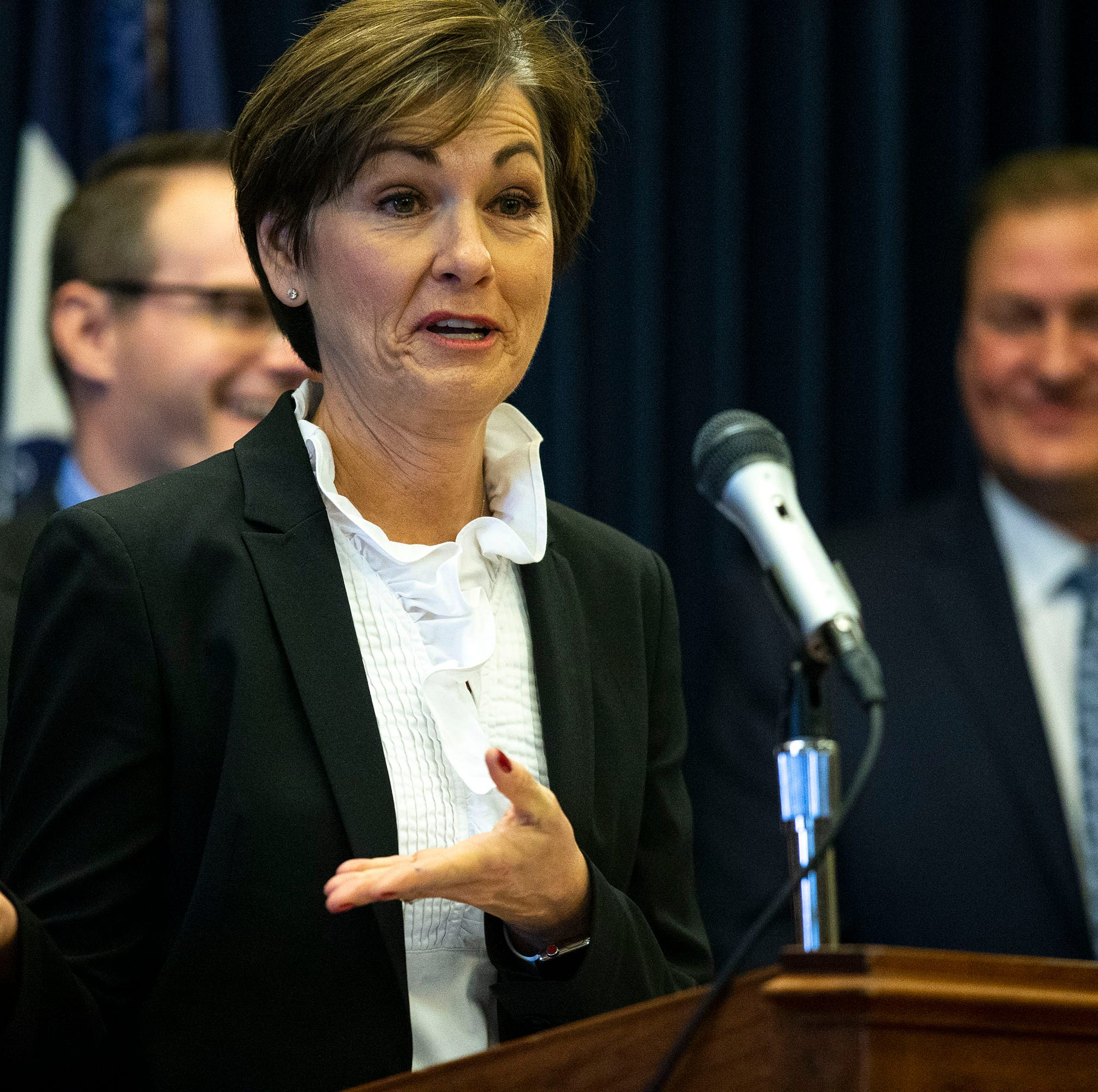 Kim Reynolds signs bill to fund health programs, cut Planned Parenthood, restrict money for transgender Iowans' surgery