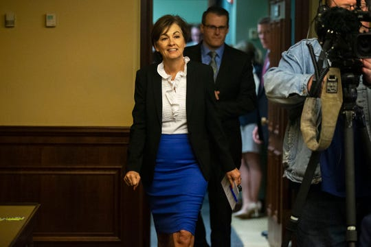 Governor Kim Reynolds enters a conference room for a news conference on Tuesday, April 23, 2019, at the Iowa State Capitol in Des Moines.
