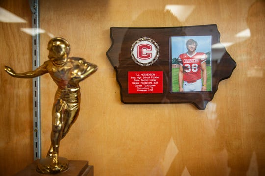 A plaque honoring T.J. Hockenson hangs in the trophy case at Chariton High School Monday, April 22, 2019.