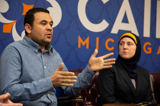 Hany Zaki, 39, of Roseville, left, sits next to CAIR attorney Amy Doukoure during a press conference held in the CAIR offices in Farmington Hills Tuesday, April 23, 2019. Zaki is a Muslim employee at LG Electronics company in Hazel Park and is part of a larger group filing a complaint of workplace discrimination, saying the company had anti-Muslim training materials during a recent active shooter training including other discriminatory behaviours at his work.