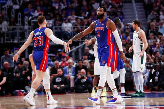 Pistons forward Blake Griffin high-fives center Andre Drummond during the first half of Game 4 of the playoff series against Bucks at Little Caesars Arena in Detroit, Monday, April 22, 2019.