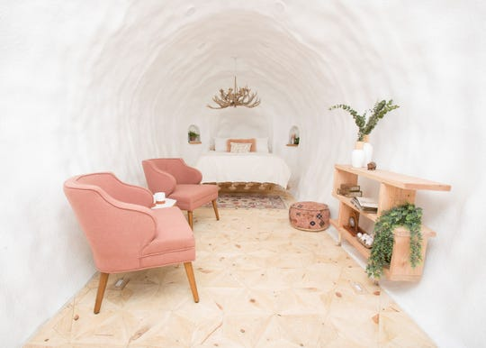 To make the potato structure cozy, it was furnished with a queen-size bed, chairs and an antler chandelier.