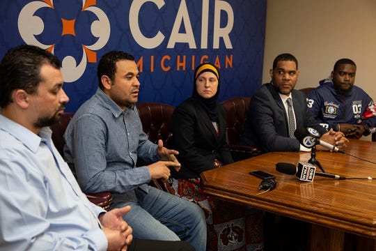 Muslim employees at LG Electronics in Hazel Park Maged Mousa, 40, of Dearborn Heights, left, Hany Zaki, 39, of Roseville and at far right Juma Sayeed, 35, of Detroit are joined by CAIR attorney Amy Doukoure and CAIR Executive Director Dawud Walid during a press conference in the CAIR offices in Farmington Hills Tuesday, April 23, 2019. The group is filing a complaint of workplace discrimination, saying the company had anti-Muslim training materials during a recent active shooter training.