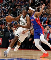 Bucks' Khris Middleton drives on Bruce Brown during Game 4 of the playoffs last season.