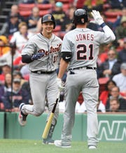 Tigers catcher Grayson Greiner, left, reacts with center fielder JaCoby Jones after hitting a home run during the fifth inning in the first game of a doubleheader on Tuesday, April 23, 2019, in Boston.