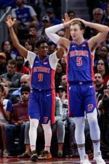 Pistons guards Langston Galloway (9) and Luke Kennard react to a foul during the second half of Game 4 of the playoff series against Bucks at Little Caesars Arena in Detroit, Monday, April 22, 2019.