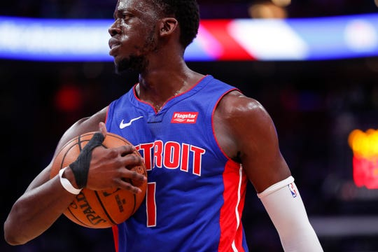 Pistons guard Reggie Jackson cradles the basketball after calling timeout during the second half of Game 4 of the playoff series against Bucks at Little Caesars Arena in Detroit, Monday, April 22, 2019.