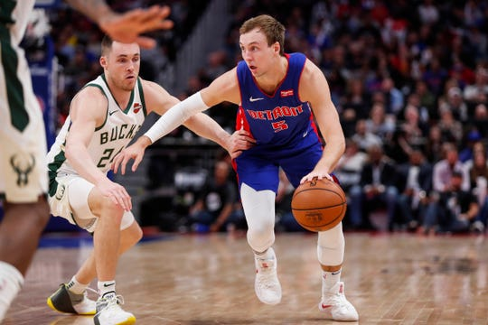 Pistons guard Luke Kennard dribbles against Bucks guard Pat Connaughton during the second half of Game 4.
