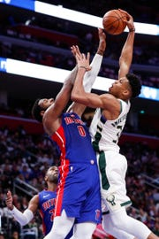 Andre Drummond tries to block a layup from Giannis Antetokounmpo during the first half of Game 4 at LCA.