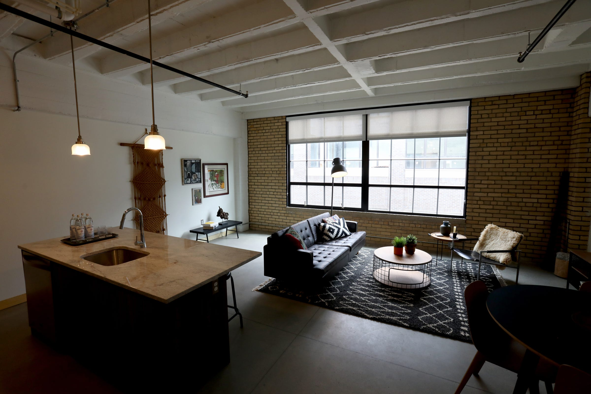 A model one-bedroom apartment with an open kitchen and living area inside the Checker Building.