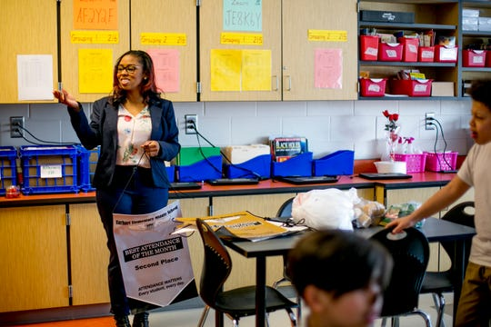 Amanda Bowman, the attendance agent at Earhart Elementary-Middle School in Southwest Detroit, works to cut the Detroit public schools' high absenteeism.