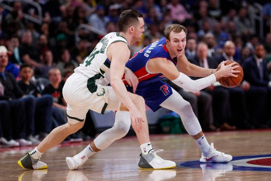 Pistons guard Luke Kennard is defended by Bucks guard Pat Connaughton during the second half of Game 4 of the playoff series at Little Caesars Arena in Detroit, Monday, April 22, 2019.