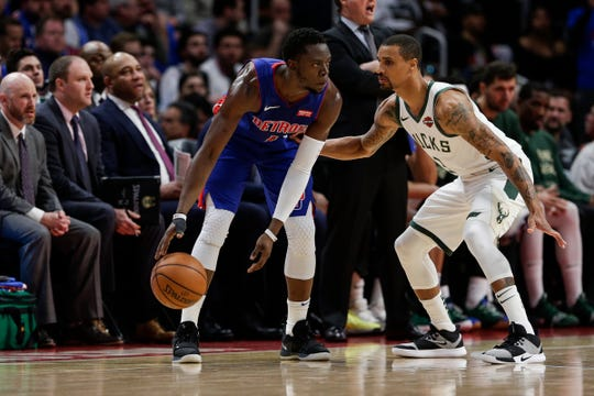 Pistons guard Reggie Jackson dribbles against Bucks guard George Hill during the first half of Game 4 of the playoff series at the Little Caesars Arena in Detroit, Monday, April 22, 2019.