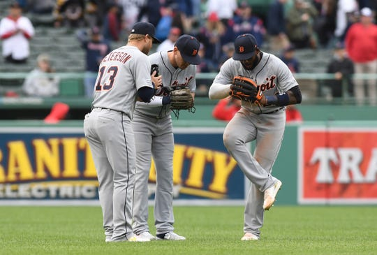 (From left) Tigers right fielder Dustin Peterson, left fielder JaCoby Jones and right fielder Niko Goodrum react after the 7-4 win over the Red Sox in Game 1 of the doubleheader on  Tuesday, April 23, 2019, in Boston.