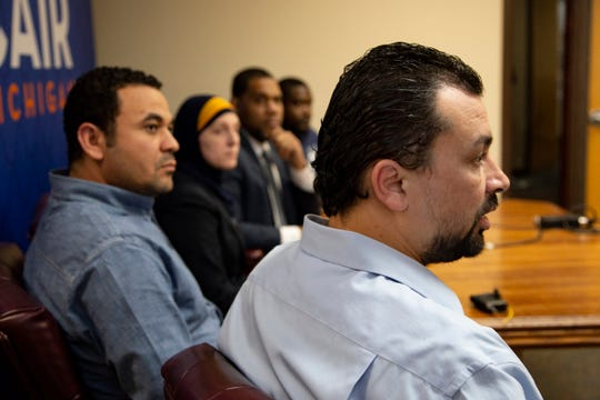 Muslim employees at LG Electronics in Hazel Park Maged Mousa, 40, of Dearborn Heights expresses himself in foreground as Hany Zaki, 39, of Roseville, left, CAIR attorney Amy Doukoure and CAIR Executive Director Dawud Walid and  Juma Sayeed, 35, of Detroit look on during a press conference in the CAIR offices in Farmington Hills Tuesday, April 23, 2019. The group is filing a complaint of workplace discrimination, saying the company had anti-Muslim training materials during a recent active shooter training.
