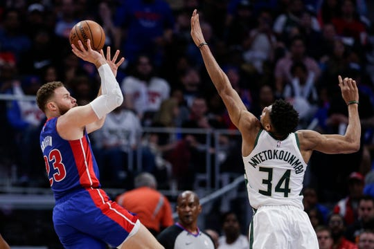 Pistons forward Blake Griffin makes a jump shot against Bucks forward Giannis Antetokounmpo during the first half of Game 4 of the playoff series at Little Caesars Arena in Detroit, Monday, April 22, 2019.