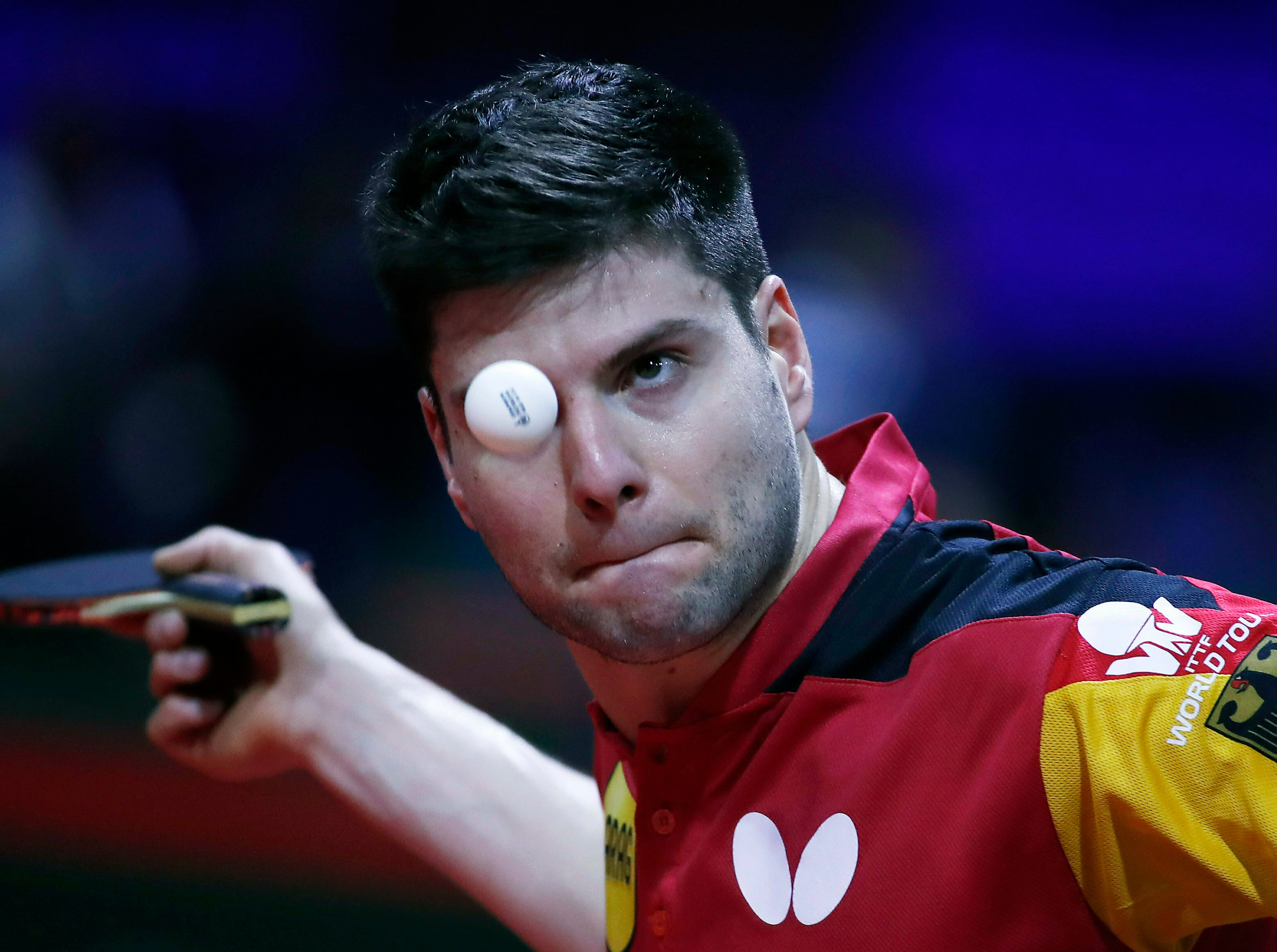 Dimitrij Ovtcharov of Germany plays against Michael Tauber of Israel during their men's single qualifying match of the World Table Tennis Championships in Budapest, Hungary, Tuesday April 23, 2019.