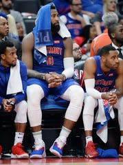 The Pistons' Andre Drummond, center, Ish Smith, left, and Wayne Ellington sit on the bench late in the fourth quarter.