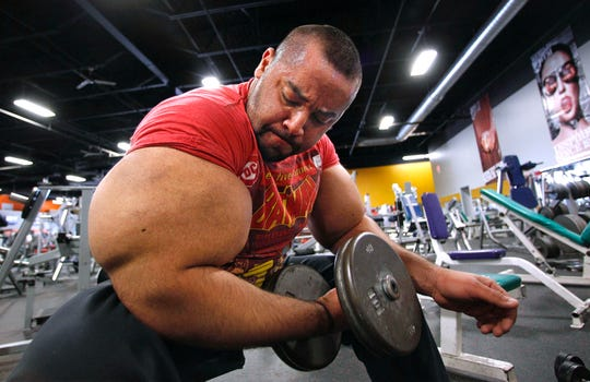 "Egyptian body builder Moustafa Ismail lifts free weights during his daily workout in Milford, Mass. On Monday, April 22, 2019, Merriam-Webster added the definition of swole to it's online dictionary, with the meaning ""extremely muscular: having a physique enhanced by bodybuilding exercises."" Ismail once was given the title of world's biggest arms, biceps and triceps, by the Guinness Book of World Records."