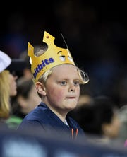 A young fan wears a Bitbits crown during a Tigers game at Comerica Park in May 2017.