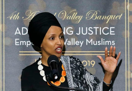 """In this March 23, 2019, photo, Rep. Ilhan Omar, D-Minn., speaks at a dinner banquet, part of a fundraising event for the Council of American-Islamic Relations of Greater Los Angeles at the Hilton hotel in Woodland Hills, Calif. Hundreds of protesters rallied outside the event where the congresswoman spoke to the Muslim-American civil rights group. Omar has drawn criticism for her recent remarks on Israel, including comments that American supporters of Israel are pushing people to have """"allegiance to a foreign country."""" Omar later apologized. (Gary Coronado/Los Angeles Times via AP)"""