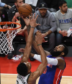 Pistons' Andre Drummond steals the ball from Bucks' Giannis Antetokounmpo and puts up a shot in the first quarter of Game 4.