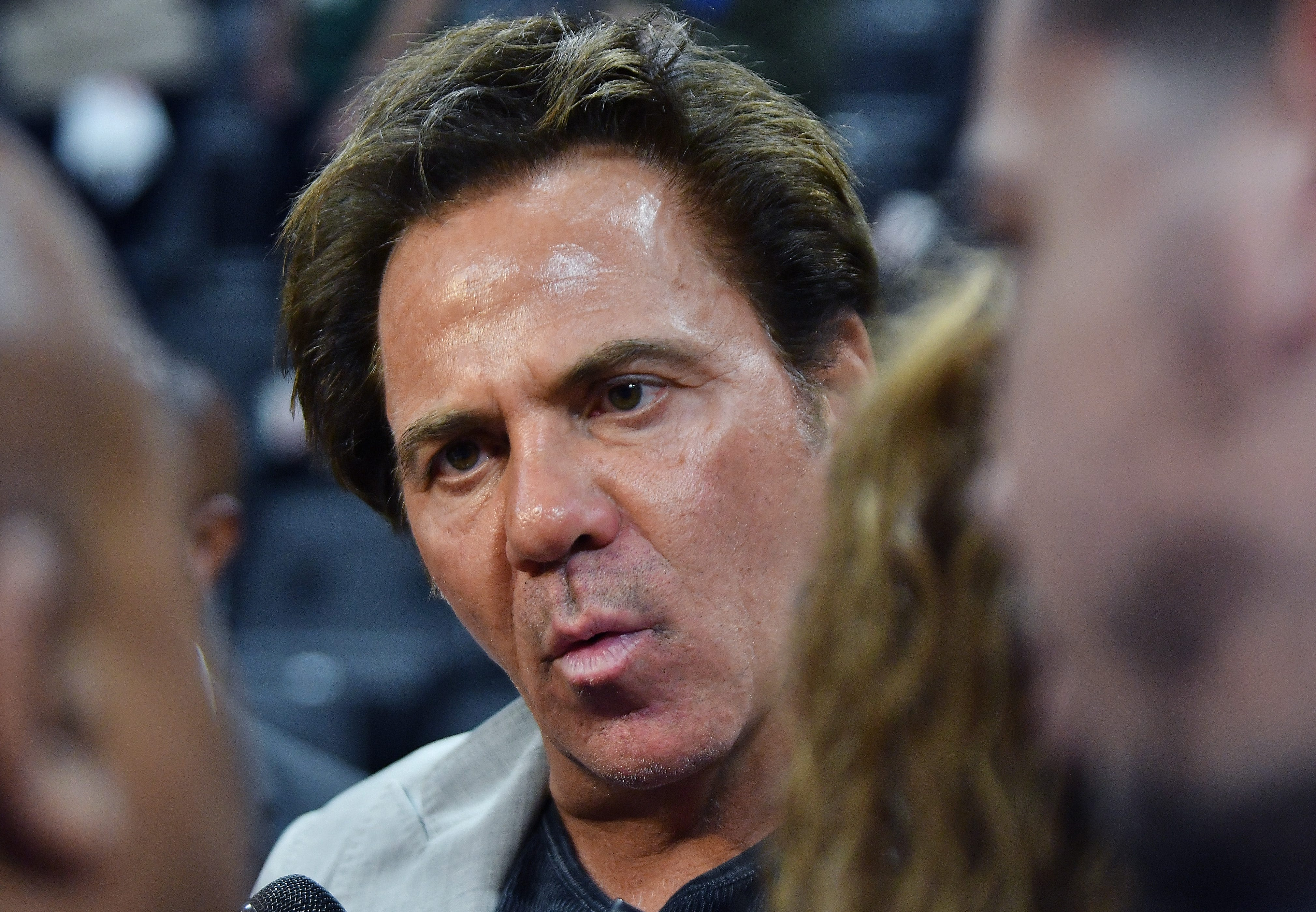 Pistons owner Tom Gores talks to members of the media after the game.