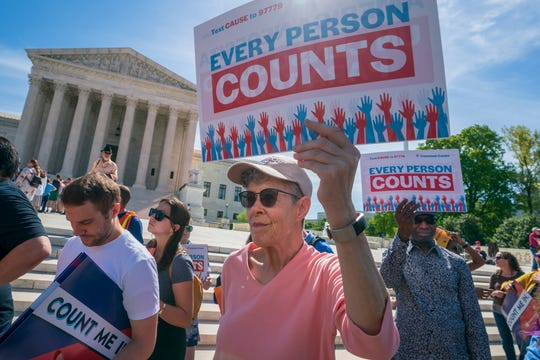Immigration activists rally outside the Supreme Court as the justices hear arguments over the Trump administration's plan to ask about citizenship on the 2020 census, in Washington, Tuesday, April 23, 2019.