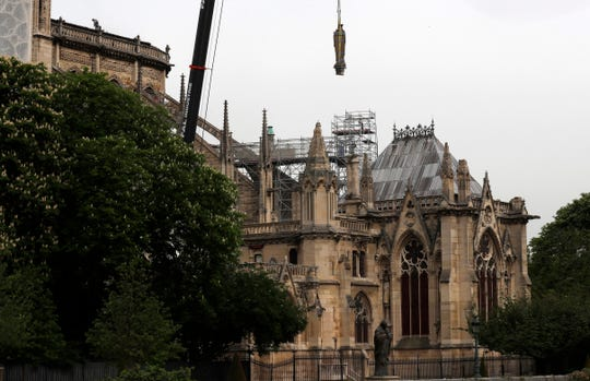 A statue is removed from Notre Dame cathedral,Tuesday, April 23, 2019 in Paris.