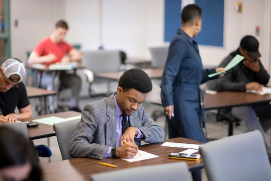 Preston Welborne El takes a final in his Accounting Procedures class at the Orchard Ridge Campus of Oakland Community College.