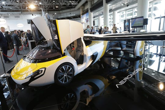 AeroMobil displays its latest prototype of a flying car, in Monaco, Thursday, April 20, 2017. The light frame plane whose wings can fold back, like an insect is boosted by a rear propeller.