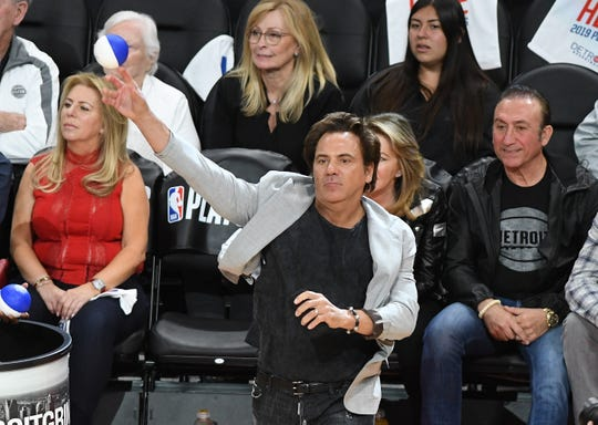 Pistons owner Tom Gores likes to throw t-shirts into the crowd.