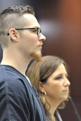 Alexander Gerth, left, stands with his defense attorney, Mariell Lehman, as he sentence to three to six years in prison for torturing and killing his two-year-old pit bull-mix 'Sterling.'