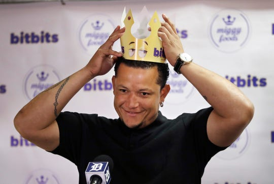 Tigers first baseman Miguel Cabrera tries on a paper crown for crunchy candy BitBits, which was Miggy Foods' first product in the United States, during a promotion at Comerica Park in May 2017.