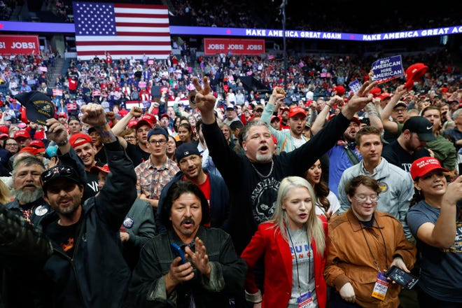Supporters of  President Donald Trump cheer before rally March 28 in Grand Rapids.