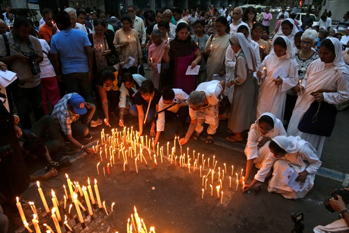 Catholic nuns and others light candles during a prayer meeting for victims of Sunday's bombings in Sri Lanka, in Kolkata, India, Tuesday, April 23, 2019. More than 300 people were killed in bombings of churches and hotels in Sri Lanka on Easter Sunday.