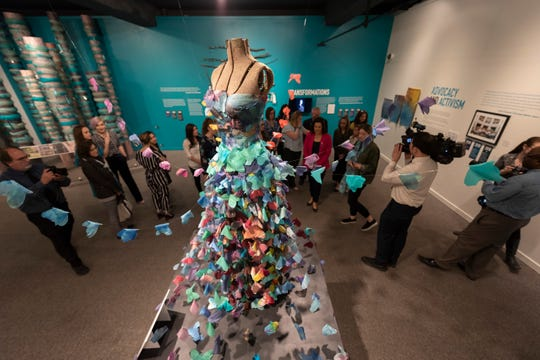 "Alexandra Bourque's sculpture ""Becoming Ten Feet Tall"" in the exhibition ""Finding Our Voice: Sister Survivors Speak"" at the Michigan State University Museum. The installation was crafted from 300 hand-made, tie-dyed silk butterflies."