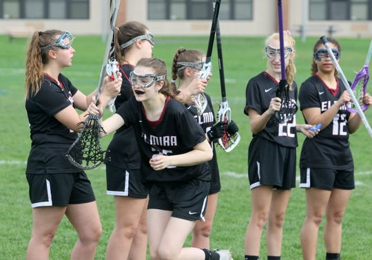 Elmira girls lacrosse players are introduced before a game against Horseheads on April 23, 2019 at Horseheads High School.