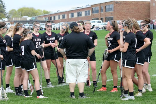 Elmira girls lacrosse coach Tammy Woodard huddles with her team against Horseheads on April 23, 2019 at Horseheads High School.
