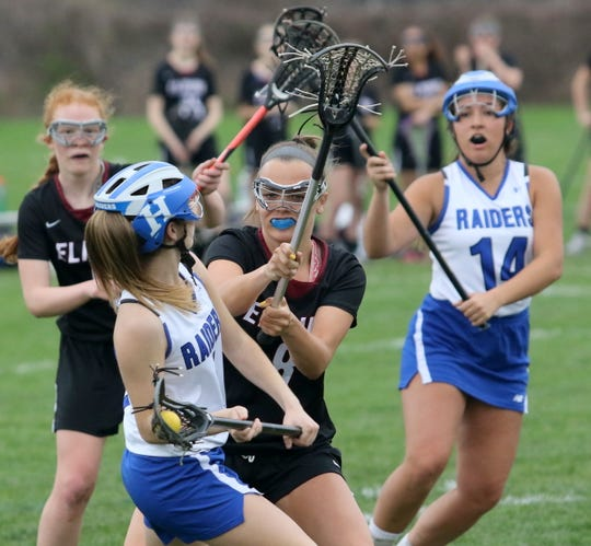 McKenna Woodworth of Horseheads is defended by Elmira's Madisyn Ross during a girls lacrosse game April 23, 2019 at Horseheads High School. In the background are Elmira's Caylee Boorse, left, and Horseheads' Bella Carberry.