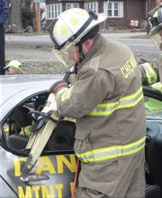 Town of Chemung Assistant Fire Chief Mike Allen demonstrates use of the Jaws of Life as part of the 2011 RecruitNY weekend.