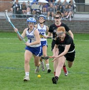 Elmira's Caylee Boorse, right, tries to pick up the ball next to Michaela Elston of Horseheads on April 23, 2019 at Horseheads High School.