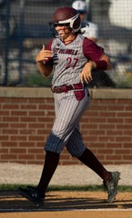 Henderson County's Hattie Hartman (27) trots home after hitting a first-inning two-run homer against Union County during their game at North Field Monday evening.