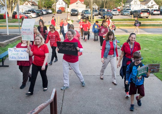 """Tekoppel Elementary teachers head into their school as they participate in Indiana's """"Red for Ed"""" Teacher Walk-in Tuesday, April 23, 2019. Teachers across Indiana participated in the walk-in to send a message to state legislators."""