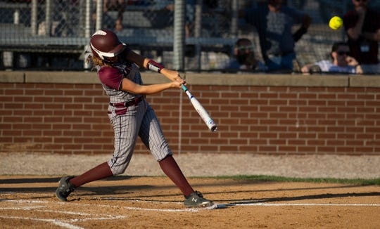 Henderson County's Hattie Hartman (27) hits a two-run home run against Union County during their game at North Field Monday evening.