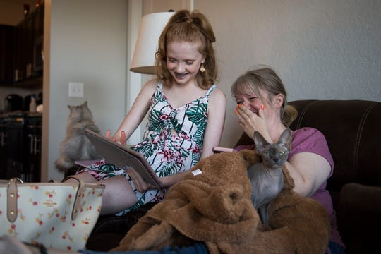 "13-year-old ASMR YouTube personality Makenna Kelly and her mother Nichole Lacy react to Kelly's footage of her eating Bob Ross ""Paint Your Tongue"" chocolate bars for her YouTube channel ""Life with MaK"" on Friday, April 19, 2019, at her home in Fort Collins, Colo."
